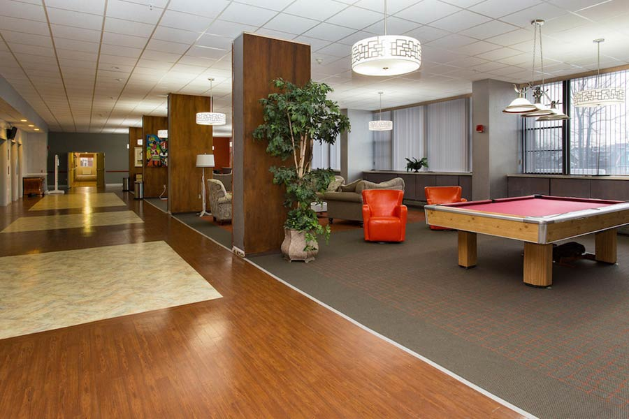 The York House clubhouse with seating areas and pool tables